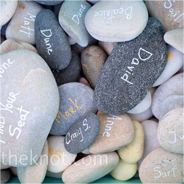 Gather stones and write guest names and table numbers on them!