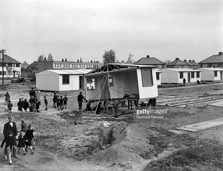 Schoolchildren helping the workmen construct a new estate of pre-fabricated houses in Watford, Hertfordshire after the devastation of World War II.