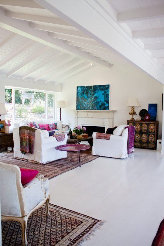 Name: David Florimbi and Nancy SimonLocation: Santa BarbaraYears lived in: 6 Nancy and David moved into a single story ranch style home in the hills of Santa Barbara, California six years ago. They preserved the bones, but opened up many of the rooms and gave the whole thing a coat of fresh white paint. The open floor plan, combined with large windows and a vibrant color palette, give this home an air of exotic getaway.