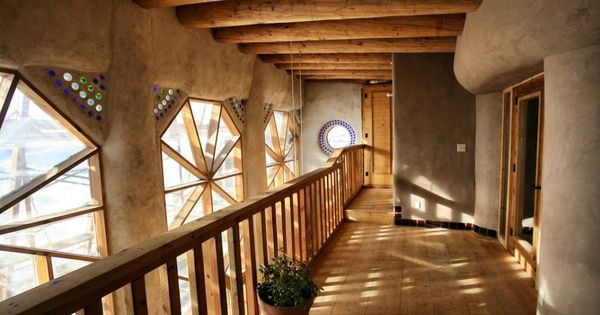 Liked on Pinterest: Hallway from Towers Earthship duplex upper level...one of the housing options for Earthship Interns and Earthship Academy students and Earthship Biotecture