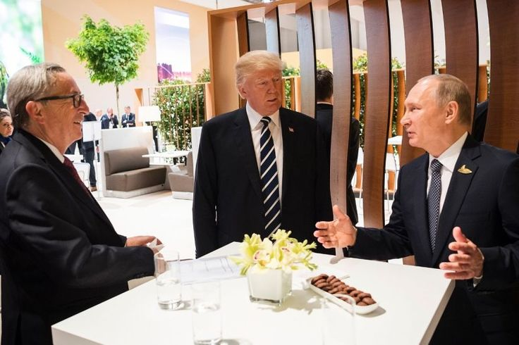 President Donald Trump, with Russian President Vladimir Putin and European Commission President Jean-Claude Juncker, at the G-20