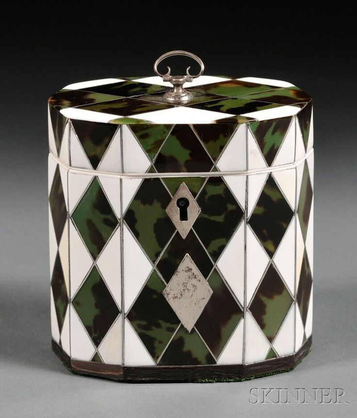 European Furniture & Decorative Arts | F - Sale 2566B - Lot 1123  Ivory and Green Tortoiseshell Harlequin Tea Caddy, England, c. 1800, decagon shape with silver piping, finial and diamond-shaped escutcheon and cartouche, horn footrim, matching interior lid, ht. 4 1/4, lg. 4 1/8 in.   Estimate $5,500-6,500     No evidence of any cracks, chips or restorations.  Sold for $11,850