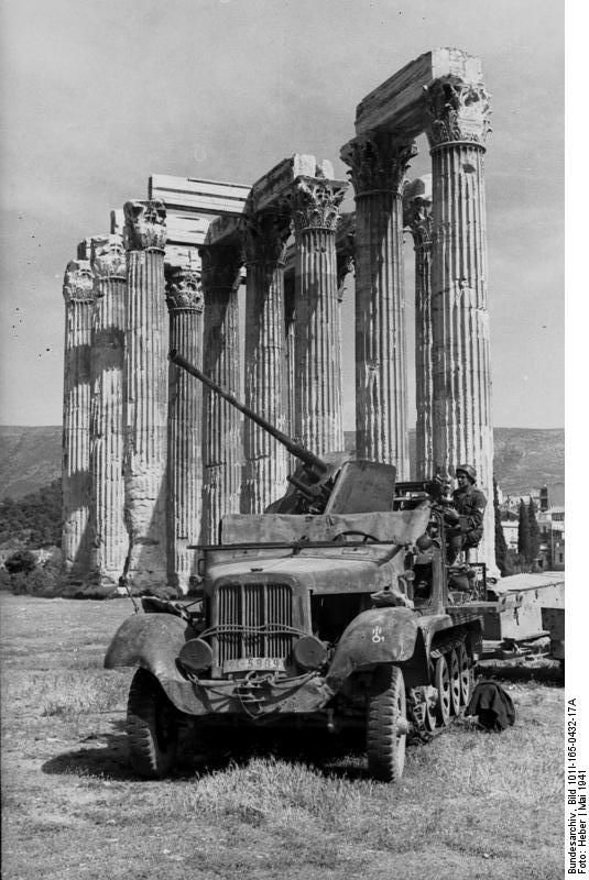 Athens, Greece, May 1941: Flak gun deployed in front of the ruins of the Temple of Zeus, a short distance from Constitution Square in the center of Athens. Mt Hymettus is in the background., #solebike, #Athens, #e-bike tours
