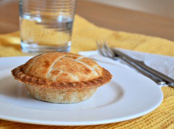 Mini Apple Pies baked in personal pie maker, uses apples, sugar, cinnamon, cornstarch & pie crust. (good link)