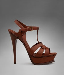 Every girl needs a gorgeous neutral heel. For these I would most definitely give up eating to save the cash. YSL Tribute High Heel Sandal in Tan Leather.