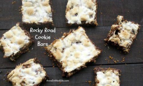 These rocky road cookie bars are made by placing layers of sweet goodness over a graham cracker crust base. These easy to make cookie bars taste a whole lot like rocky road candy! If you like road candy, you will love these melt in your mouth delicious Rocky Road Cookie Bars!