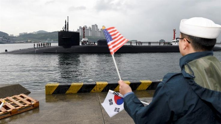 Flurry of diplomacy under way as North Korea reportedly marks military anniversary with large-scale artillery drill. The guided-missile submarine USS Michigan arrived in Busan, South Korea A US submarine has arrived in South Korean waters, while envoys from the US, Japan and South Korea met in Tokyo to discuss rising tensions with North Korea. Pyongyang … Continue reading US submarine arrives in South Korea as envoys meet →