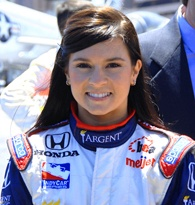 Auto racing has always appeared to be an aggressively masculine activity, with the role of women limited to the bikini-clad beauties handing out trophies. The current racing roster, however, has one beauty clad in the same suit as the boys. Danica Patrick debuted on the Indy Racing League scene in 2002; since that time, she has earned two Rookie of the Year awards and became the first woman to win an IndyCar race.Danica Patrick was born on March 25, 1982 and raised in Roscoe, Illinois.