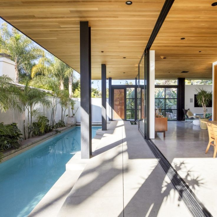 This luxurious home is surrounded by a lap pool, a koi pond, and various tropical plants. Inside, there is a floating wall entry, wood ceilings, and 5 bedrooms. There is also a studio with its own bathroom and patio that is attached to the main home via a bridge. It also includes incredible views and is less than a mile from the Venice Beach boardwalk. #losangelesca #socalhomes #venicebeach #dreamhomes Shannon Jones | Keller Williams Coastal Properties | DRE#01247705