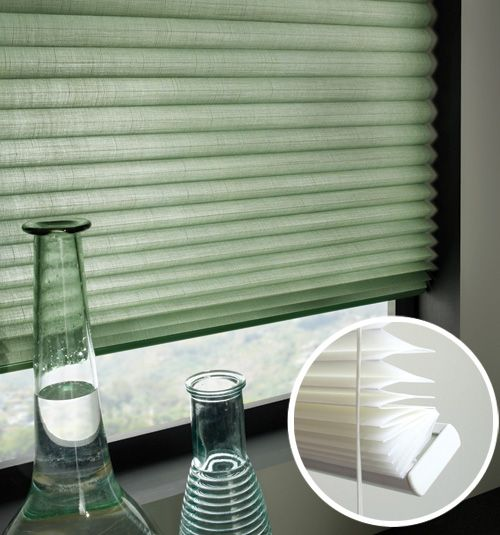 The Linen No-Holes Pleated Shade from Blindsgalore features a crisply folded, textured fabric that is semi-opaque, allowing some natural light to enter the room while still providing privacy.