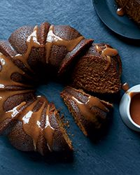 Porter Bundt Cake with Whiskey-Caramel Sauce | This best-ever porter cake with whiskey sauce gets flavor from porter beer, molasses and warm spices. Get the recipe from Food & Wine.