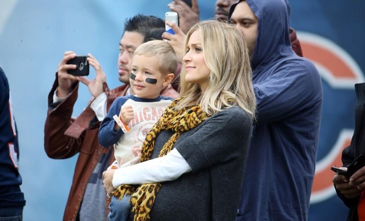 Jay Cutler's wife Kristin Cavallari watches warm-ups before the Bears-Raiders game at Soldier Field.