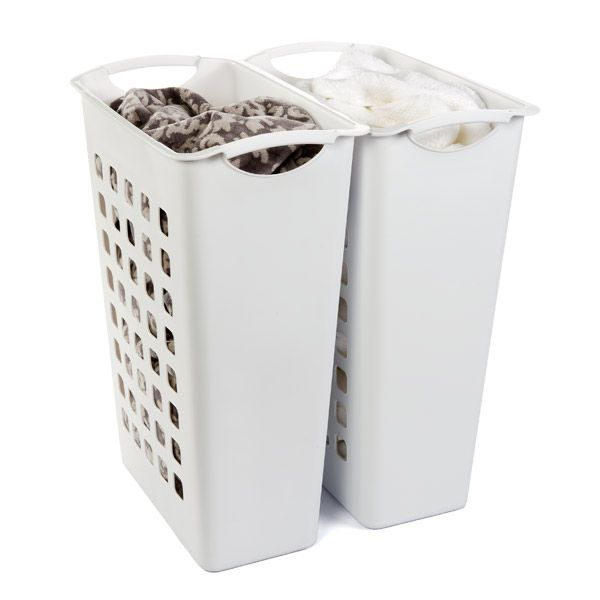 Since no one in the world makes a 4-bin laundry sorter, I can just buy 4 interlocking hampers.