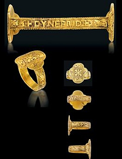 AN EXTREMELY RARE ANGLO SAXON GOLD RING mid 9th-century Of lobed quatrefoil design, each of the four panels decorated with a stylised creature, which from the top, appear to be a hare or rabbit, a bird of prey, a swan and a dog; at the centre there is a flowerhead with eight petals. The hoop with lettering reading CYNEFRID between two crosses and flanked by a stylised deer and a hare to each shoulder. The decoration and lettering would have stood out from the niello background.