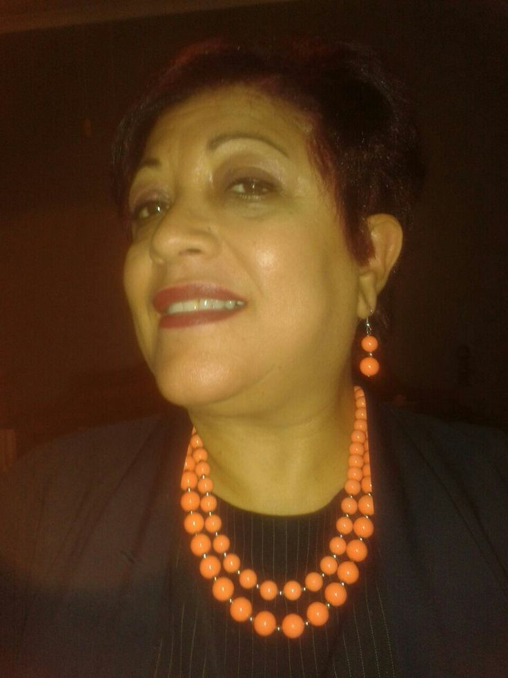 orange necklace and earrings - happy client
