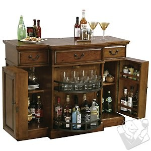 The Howard Miller Shiraz Hide-A-Bar console has raised door panels and offers generous room for wine and spirits. Perfect for any bar! #wineenthusiast