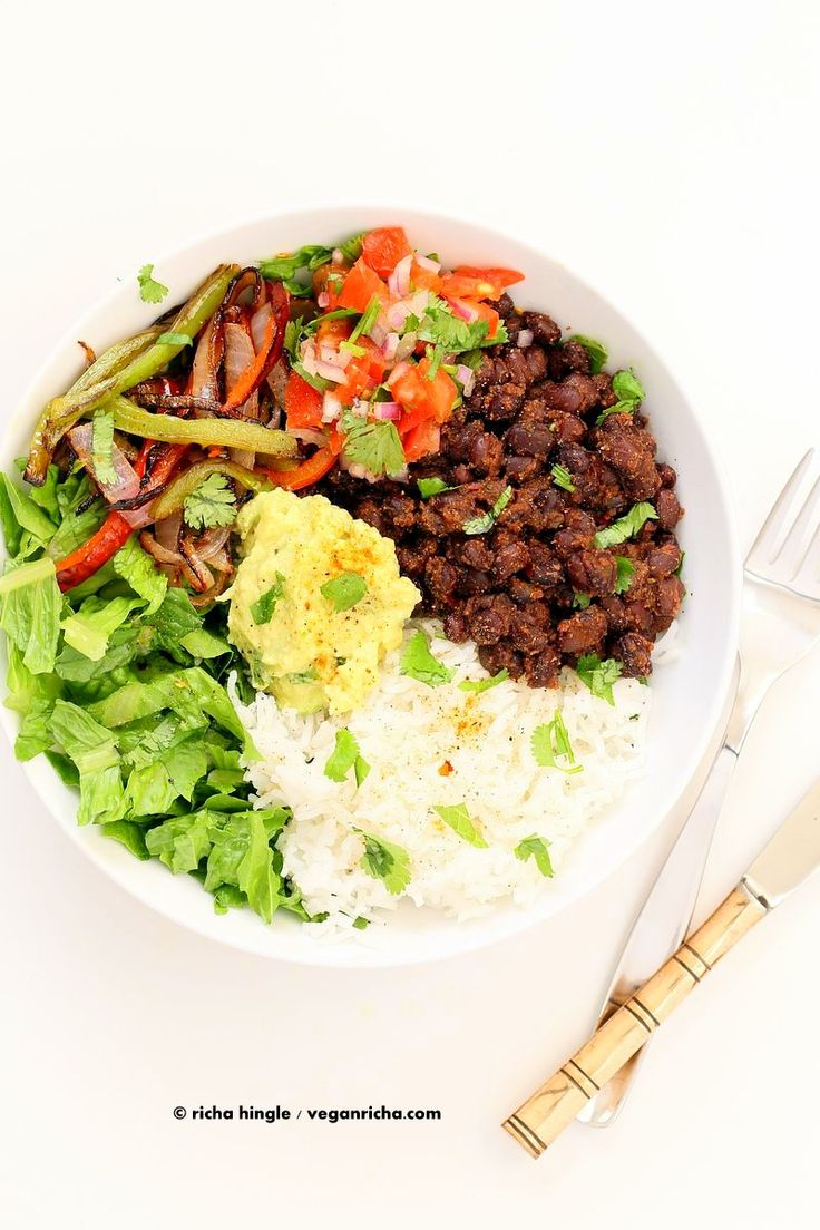 Easy Black Bean Burrito Bowl. Spicy black beans, roasted peppers and veggies, zesty guacamole, pico de gallo, fresh lettuce. DIY Burrito Bowl Chipotle style. | VeganRicha.com