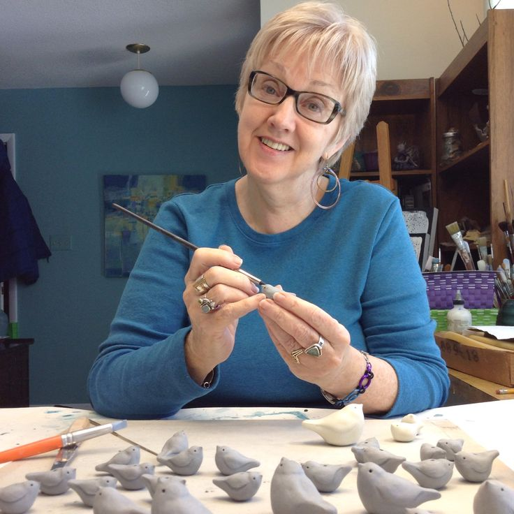 Sue is making clay birds ..these will be used on jar lids and to make necklaces.