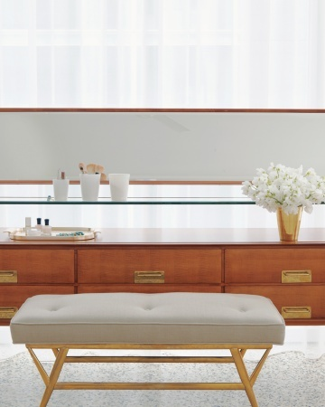A Great Vintage-Alexis Stewart vanity.    The 1960s vanity by Italian designer Silvio Cavatorta in Alexis's room was a lucky score from 1stdibs. She paired it with a vintage bench, its slim brass legs echoing the home's other fixtures.     Vanity, by Silvio Cavatorta, orangefurniture.com. Italian bench with solid-brass base, lostcityarts.com.