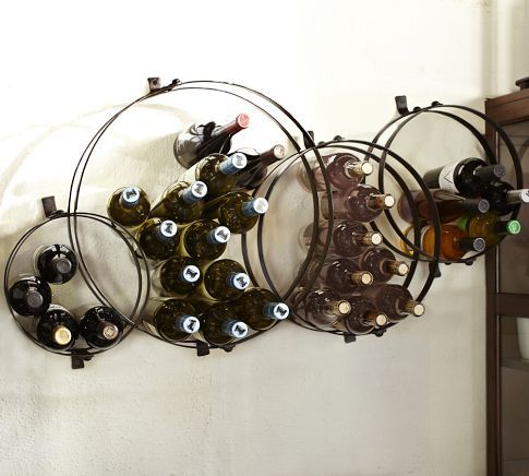 Circles Wall-Mount Wine Rack from Pottery Barn. To keep surfaces clear from using a traditional wine rack.