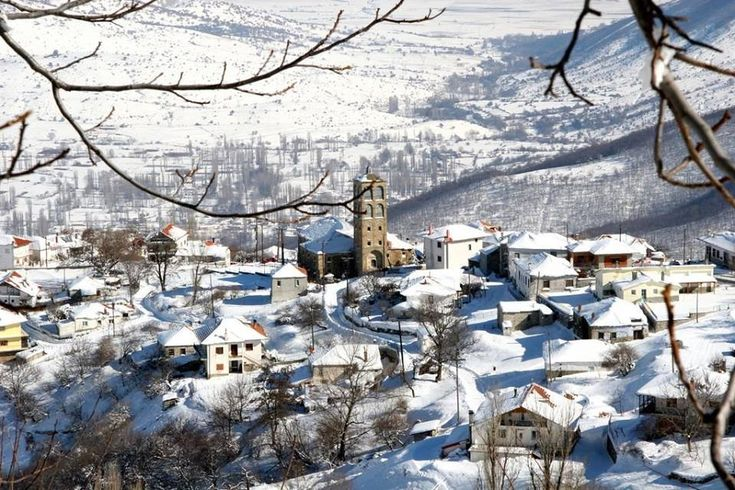 The beautiful village of #Kleisoura in #kastoria covered in snow. | #Photography Giorgos Kostikidis | #travel #Nature #snow #christmas #VisitGreece #Macedonia #Greece