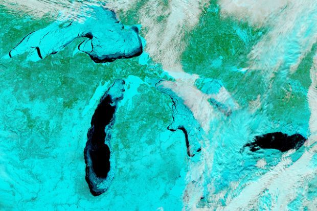 Bird's-Eye View: On Feb. 19, NASA's Aqua satellite snapped this color-filtered image of North America's frozen Great Lakes. According to the National Oceanic and Atmospheric Administration Great Lakes Environmental Research Laboratory, ice cover on the Great Lakes peaked at 88 percent on Feb. 13—an amount not recorded since 1994. (Photo: NASA Handout/Reuters)