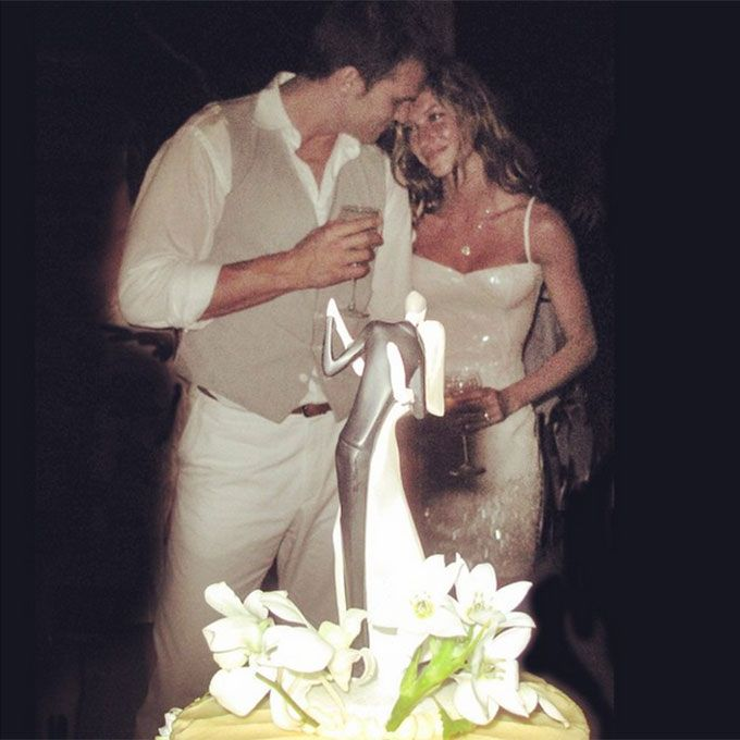Brides.com: . Gisele Bundchen marries Tom Brady in a body-skimming sheath, 2009.