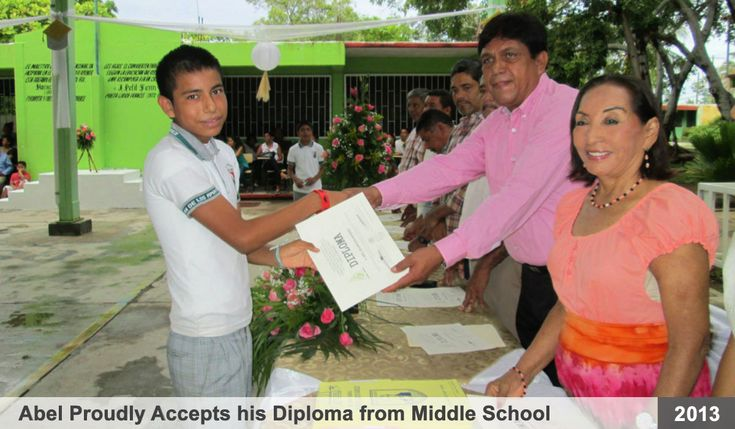 "Abel is pictured here proudly receiving his diploma, in July of 2013, from ""Escuela Secundaria"" - what we call 'High School' in the U.S.A.  Also pictured is Jovita Godínez, the founder and director of the Marsh Children's Home in Acapulco, Mexico. Education is our primary focus at the Marsh Home.  All children are required to go to school and complete there homework, daily, after returning from school."
