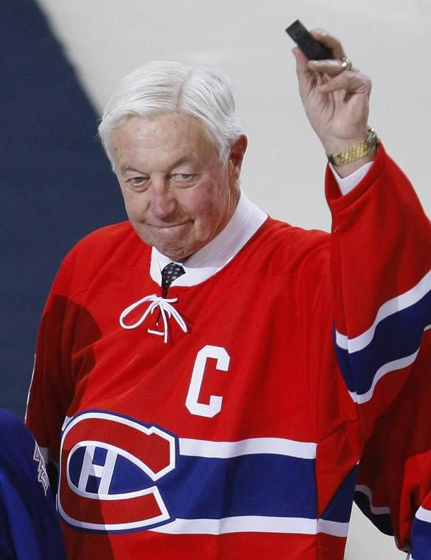Montreal Canadiens great Jean Beliveau waves to the crowd during a pre-game ceremony before the team's NHL hockey game against the Toronto Maple Leafs in Montreal in this January 8, 2009 file photo. Beliveau died at the age of 83 on December 2, 2014, the team announced. (SHAUN BEST/REUTERS)