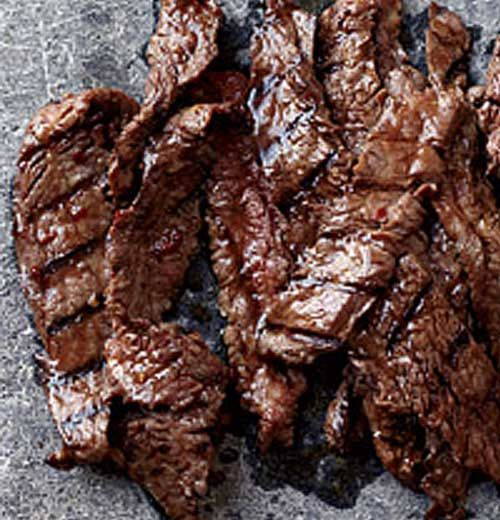 Korean Sizzling Beef - This succulent recipe is based on bulgogi, a classic Korean dish of sliced beef that's marinated in soy sauce, sugar, sesame oil and garlic, then grilled