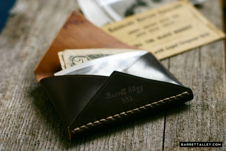 I am currently using a Jimi wallet. This looks like the classy step up. Basically, a leather pouch that can hold some cards and cash, nothing more.