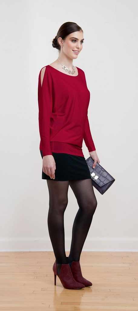 Bat sleeve tunic with on-trend shoulder cutouts can be worn casual with leggings or dressed up with a fitted skirt