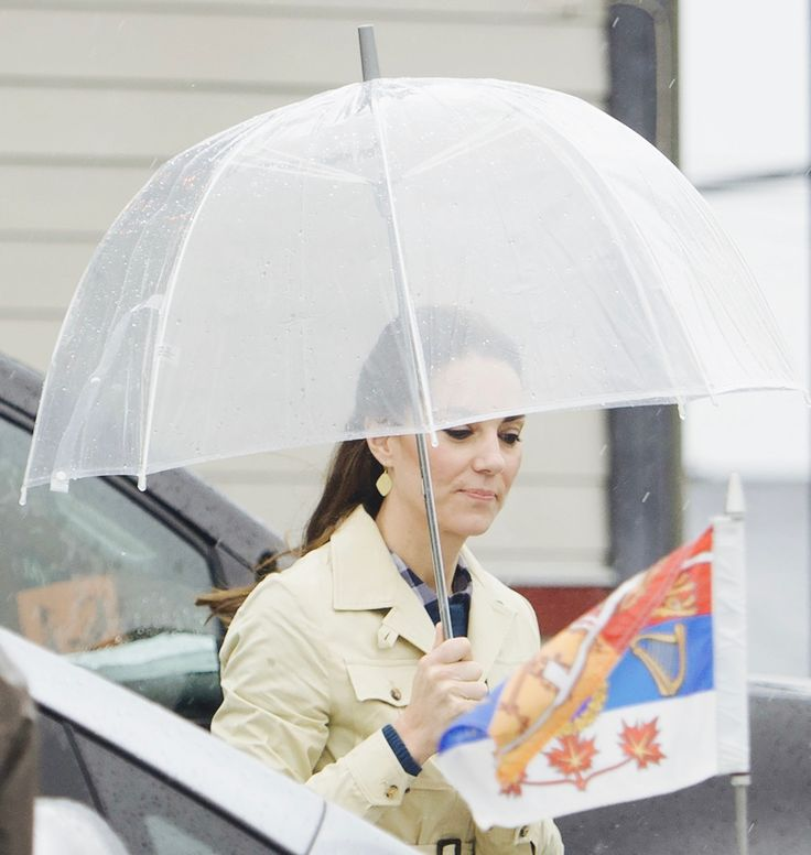 """""""26 September 2016   Catherine, Duchess of Cambridge looks on from an umbrella after arriving in Bella Bella, British Columbia. © AFP """""""