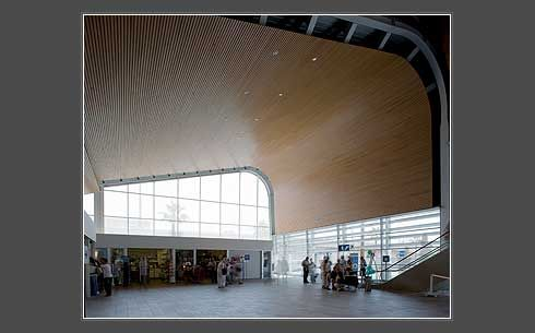 Cruise Ship Terminal Barcelona. Designed by Architect/Specifier: Grupo JG, featuring .  Hunter Douglas curved open Linear Wood Ceiling.  #wood #wood ceilings #architecture #hunter douglas