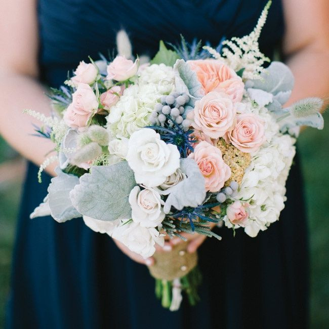 Peach garden and spray roses, thistle and dusty miller were the perfect romantic accents to the bridesmaid bouquets.