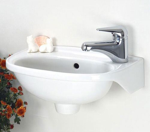 Tiny little sink. $134.95 at Signature Hardware Look at that! Maybe for the basement bath.