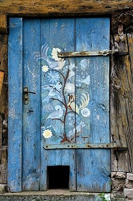 Old wooden door with cat flap, painted a bright cheery blue with birds, Simonshofen, Middle Franconia, Bavaria, Germany, Europe