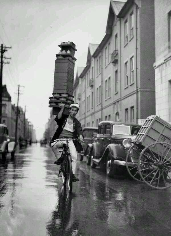 A delivery boy for a Japanese restaurant carrying soba