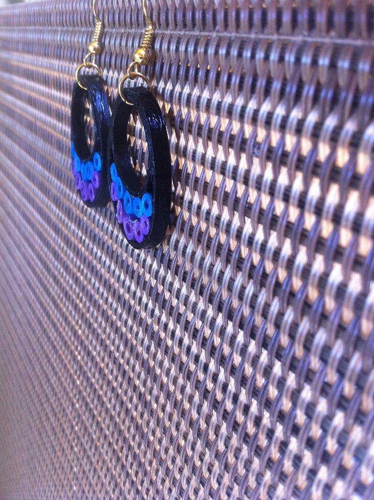Black and blue earring
