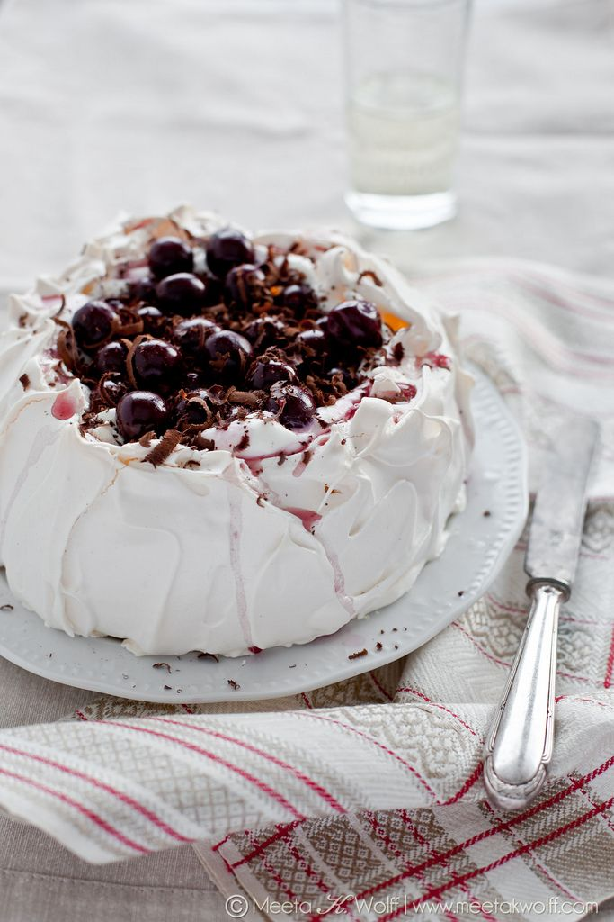 A delectable Black Forest pavlova filled with quark cream, Morello cherries and chocolate shavings. Wanted some very delicate and diffused lighting here to highlight the delicate meringue and the whites/vanilla colors. Keeping props very simple so that the emphasis is on the pavlova. [Photo & styling by Meeta K. Wolff. Recipe: http://www.whatsforlunchhoney.ne]