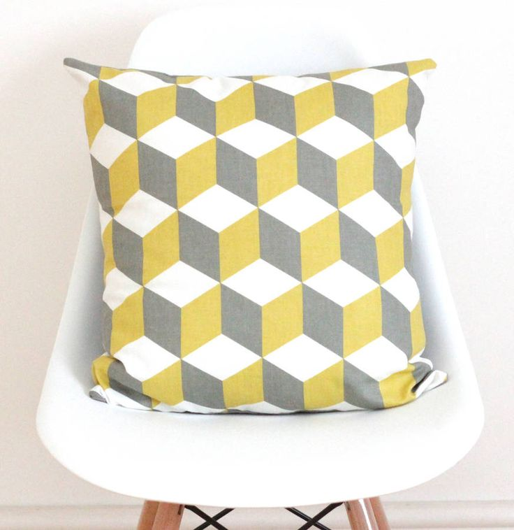 A bright geometric cushion cover in yellow and grey squares.Choose from yellow and grey or black and greyBrighten up your home with this bright yellow and grey geometric squares cushion cover. Would look great in any room to liven up a dull space. Made from medium weight linen fabric this geometric square pattern is a popular scandi style trend, the reverse is a lovely natural grey linen. You have the option of just the cushion cover only where you will need a 45cm cushion pad or 50cm…