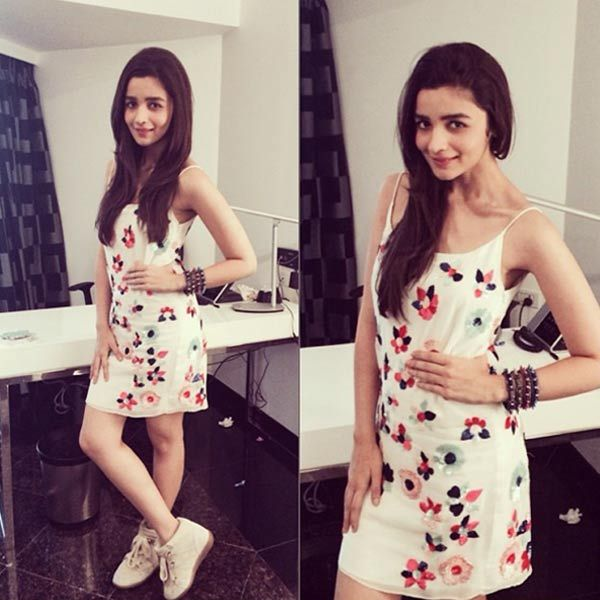 Alia wears a pretty tank dress by Natasha Dalal and Isabel Marant sneakers with panache.