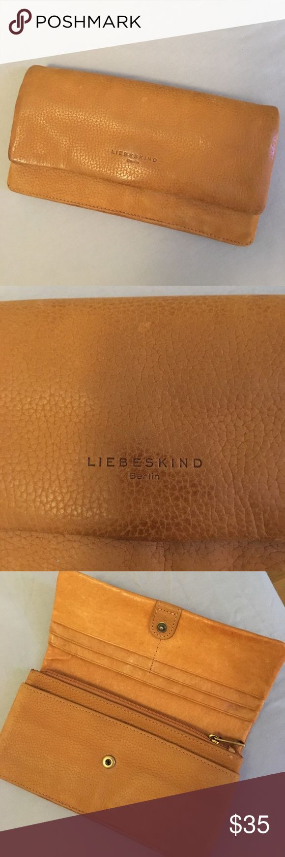 """Liebskind Berlin Leather Wallet This is a Liebskind Berlin buttery tan leather wallet.  Full size and with lots of card holders and both an interior and exterior coin holder.  Approximately 7.5"""" long and 4"""" wide.  Slight wear on the corner of the front flap, but overall in very good used condition.  I used this for traveling-matches the Pour La Victoire bag I also have in my closet in case you want to bundle. ;). Liebeskind Bags Wallets"""