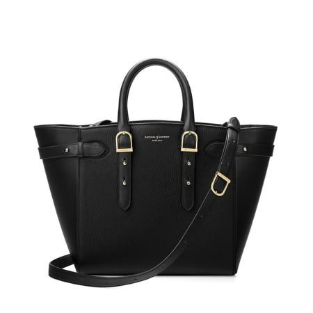 Part of the Marylebone Family, we present the Midi Marylebone Tech Tote. Handmade from the finest black pebble textured Italian calf leather, the Midi Marylebone is a super practical mid-sized version of our iconic Marylebone with an added...