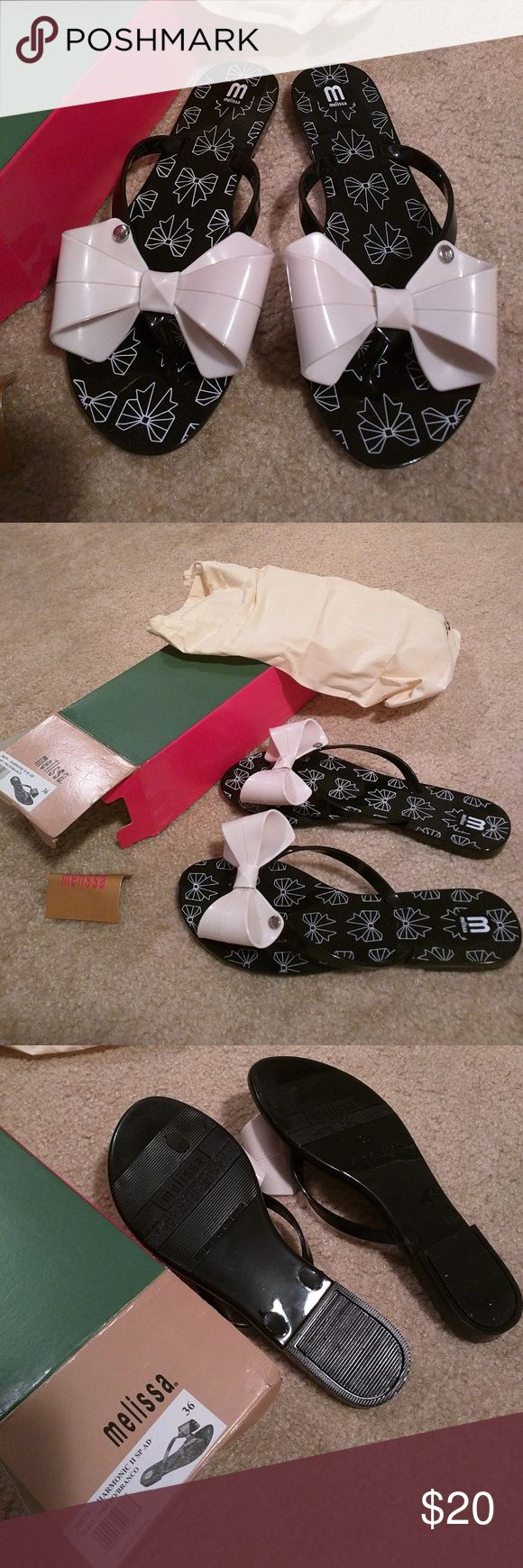 Bow Thong Flip Flops from Brazil These plastic flip-flops have a pleasant smell to them. They come with the original box, fabric bag, and inspirational insert. Made in Brazil and bought in Brazil. The colors are black and white. Melissa Shoes Sandals
