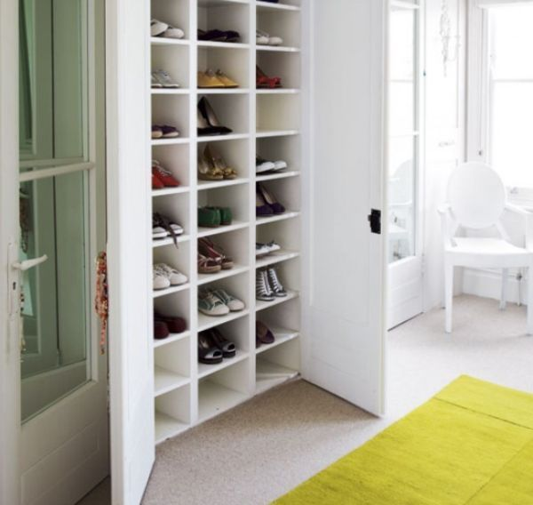 A large storage unit that can hold lots of shoes in your entryway and hide them all behind two closet doors. (from homedit.com)