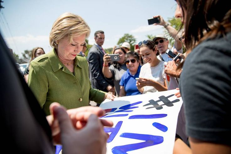 2016-08-03: Democratic presidential candidate Hillary Clinton signs a poster after taking a tour of the Knotty Tie Company in Denver.