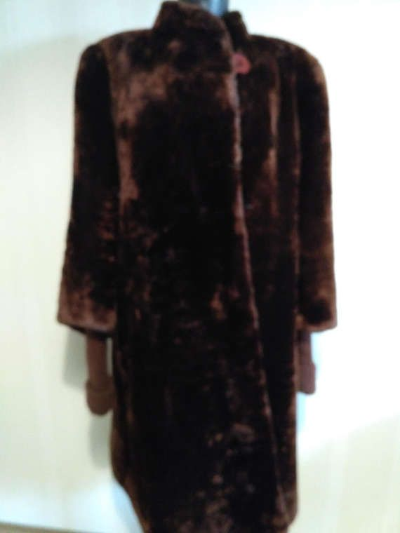 Check out this item in my Etsy shop https://www.etsy.com/listing/508972084/elegant-long-fur-coat-of-fur-mouton-fur