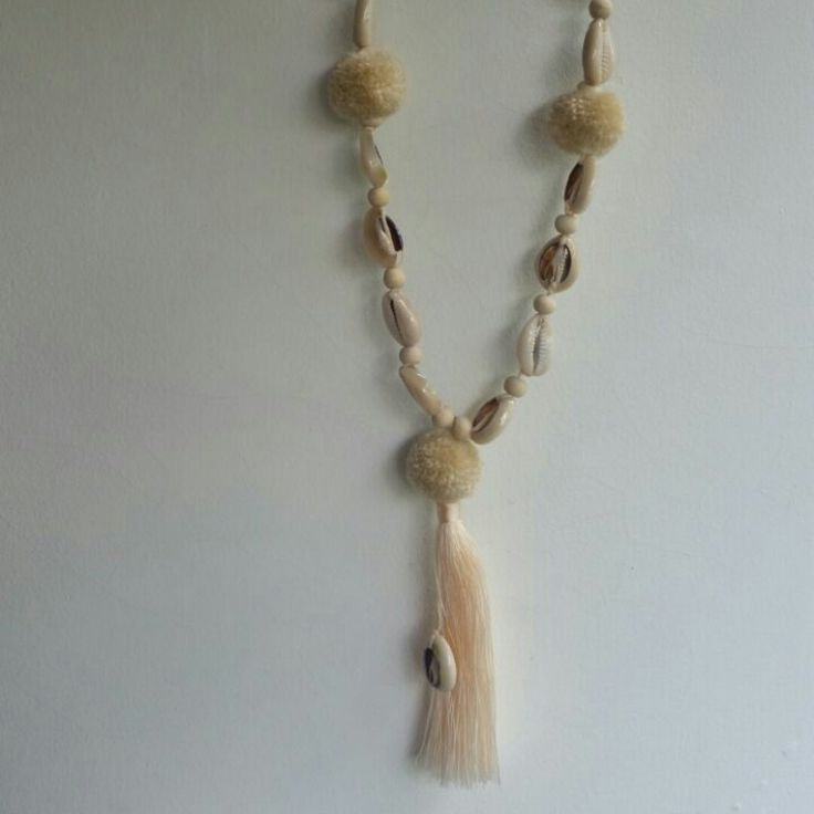 New colour in the shell and pom pom necklace