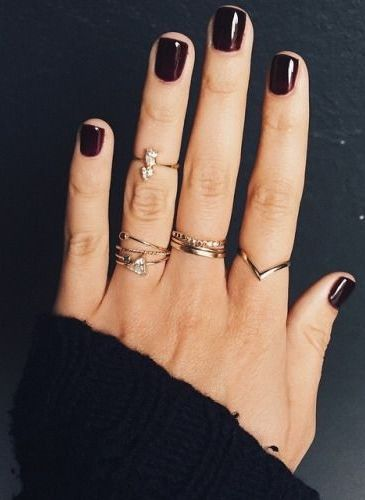 Simple stacked rings with Oxblood nails.